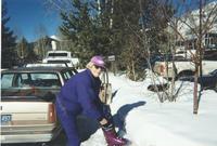 Teri Fray putting on ski boots photo