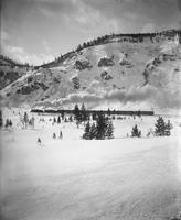 Winter Scene with Train Passing Through